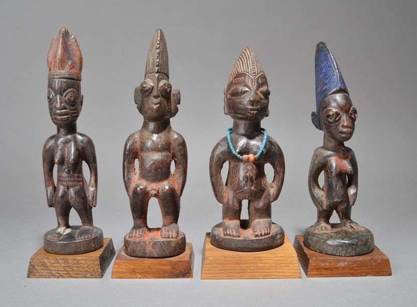 Four Yoruba Ibeji figures Nigeria including a male and three females, one with a…