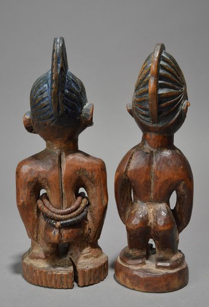 Two Yoruba Ibeji female figures Nigeria both with crested coiffures and one with…
