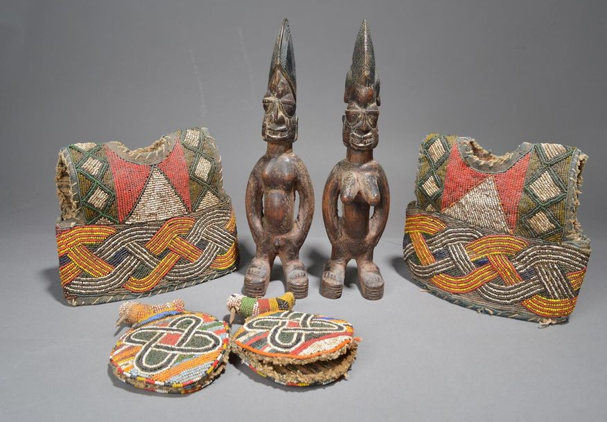 A pair of Yoruba Ibeji figures Nigeria male and female, with differing coiffures…