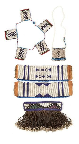 A Ndebele cache sexe South Africa glass beads, cloth and fibre tassels, 12.5cm l…