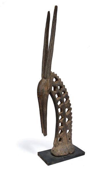A Bambara antelope headdress chiwara Mali with a pierced neck and straight spira…