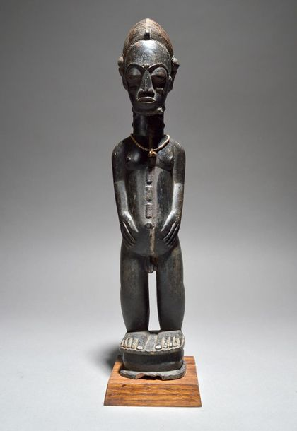A Baule male figure Ivory Coast with a finely carved coiffure, facial and body s…
