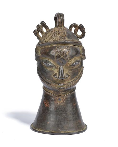 A Yoruba Ijebu hand bell omo Nigeria bronze, of human head form with a part dice…