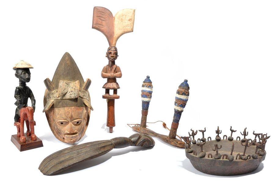 A Yoruba Shango wand Nigeria with a standing figure with a drum and having a thu…