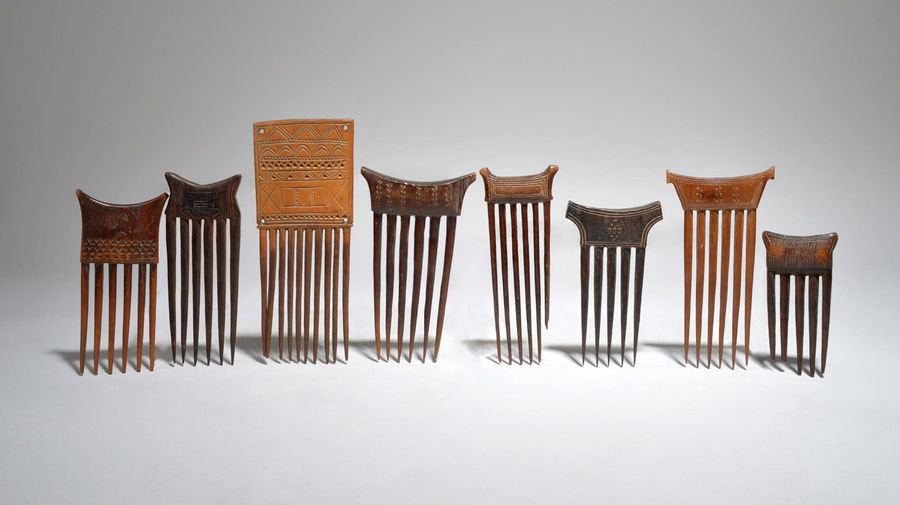 Eight Baule combs Ivory Coast with carved geometric decoration, the longest 21cm…