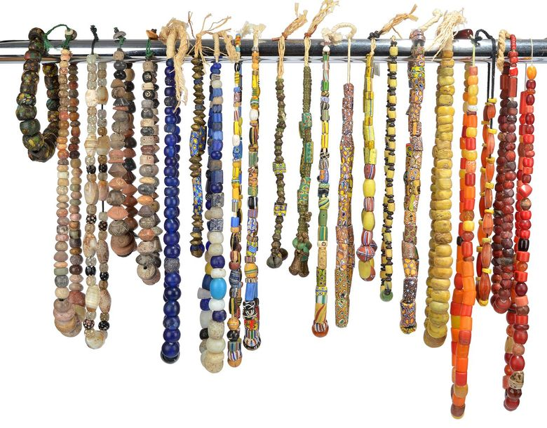 Twenty two bead necklaces glass trade beads, stone and brass. (22)