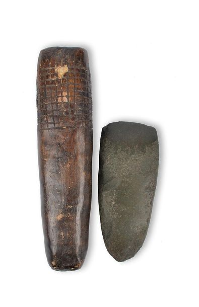 A Papua New Guinea axe head Melanesia greenstone, 16.5cm long, and a stone tapa …