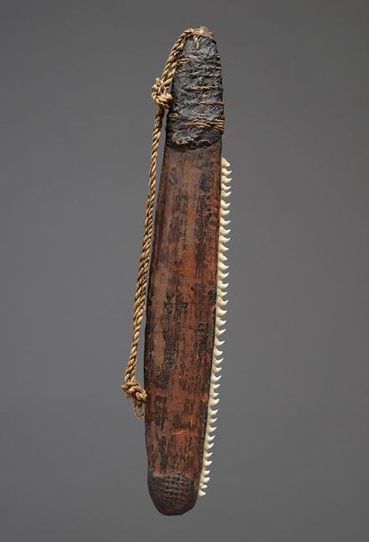 An Aboriginal knife Australia wood with inset possum teeth to one side, with a g…