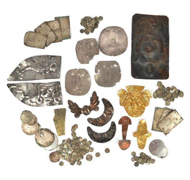 A collection of Peru and Colombia mounts gold, silver and copper, including an e…