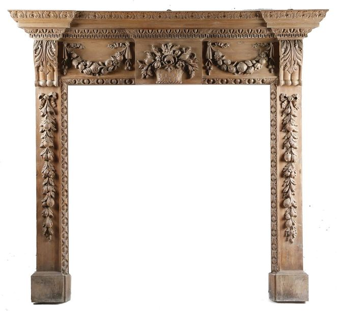 A CARVED PINE FIRE SURROUND / CHIMNEY PIECE IN GEORGE II STYLE LATE 19TH CENTURY…