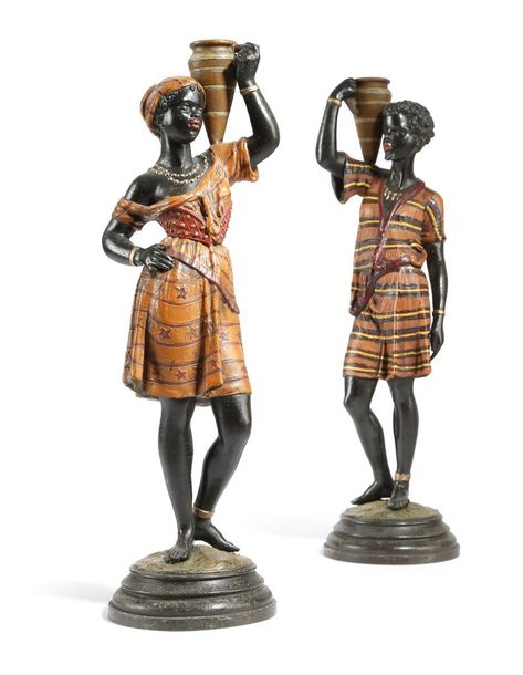 A PAIR OF COLD PAINTED SPELTER CANDLESTICKS IN THE FORM OF BLACKAMOORS LATE 19TH…