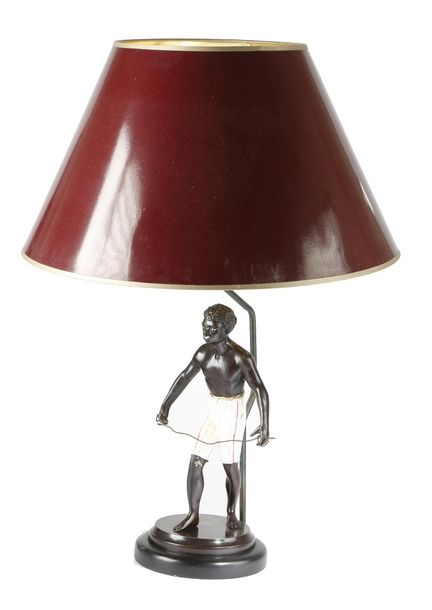 A PAINTED SPELTER BLACKAMOOR TABLE LAMP FIRST HALF 20TH CENTURY on an ebonised b…
