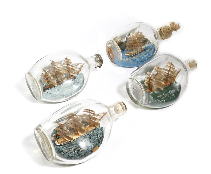 FOUR SHIPS IN A BOTTLE FIRST HALF 20TH CENTURY depicting sailing ships, three in…