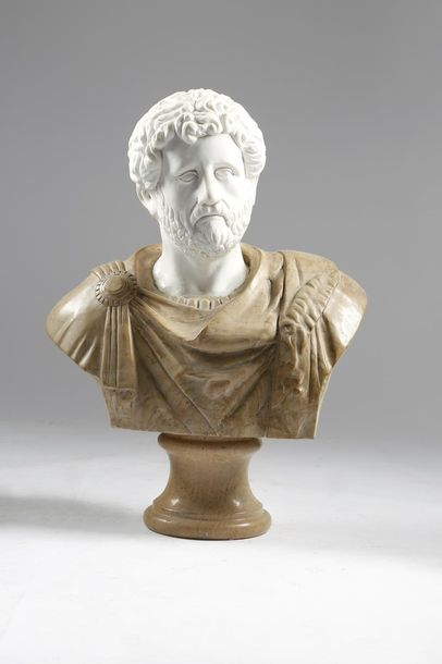 AFTER THE ANTIQUE. A CARVED MARBLE BUST OF THE ROMAN EMPEROR COMMODUS 20TH CENTU…
