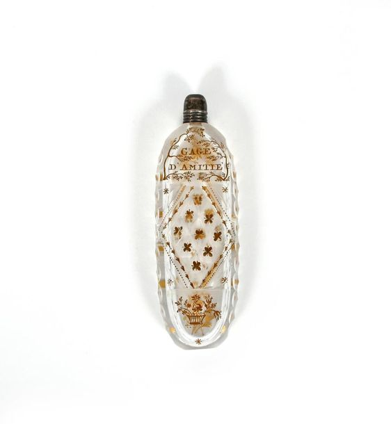 A glass cut glass scent bottle late 18th century, of flattened oval form, gilded…