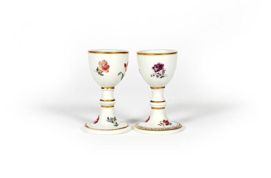 Two Italian porcelain egg cups late 18th century, probably Doccia, the U shaped …