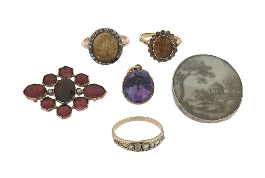 A George III diamond set gold ring, with a foliate pattern under the glazed comp…