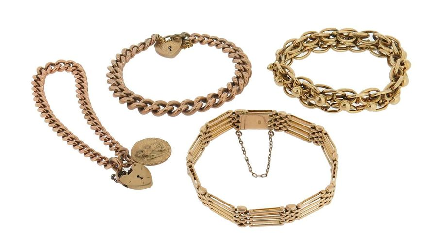 Four gold bracelets, one with gate links, one fancy link gold bracelet, and two …