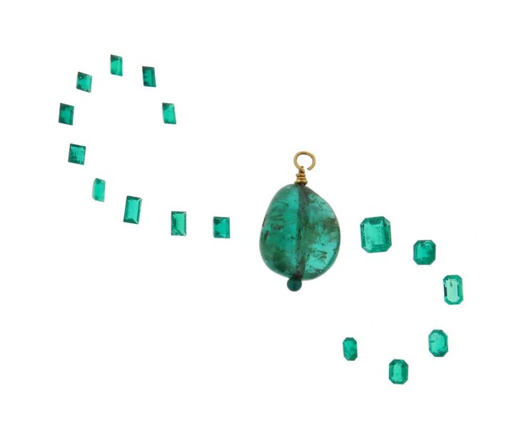 An emerald bead pendant, mounted in gold, 3.6g and sixteen loose emeralds weighi…
