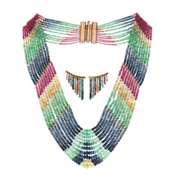A faceted multi gem bead necklace, set with rubies and multi coloured sapphires,…