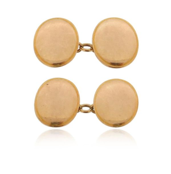 A pair of gold cufflinks, the plain oval discs in 15ct gold, 17mm high