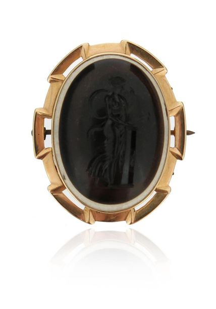A 19th century banded agate intaglio brooch, depicting Cassandra in profile with…