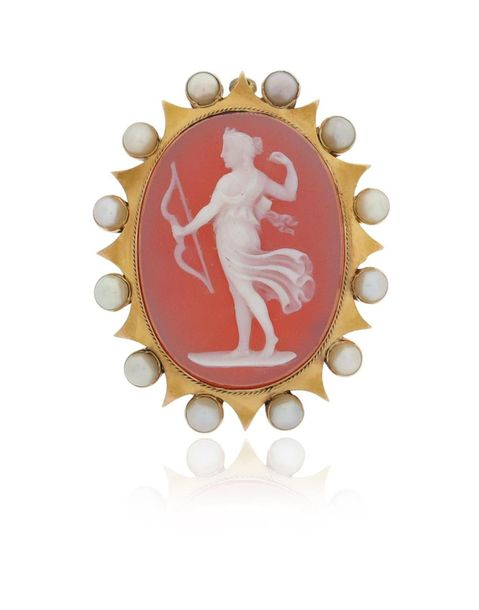 A 19th century cameo brooch pendant, the carved hardstone cameo depicts the godd…
