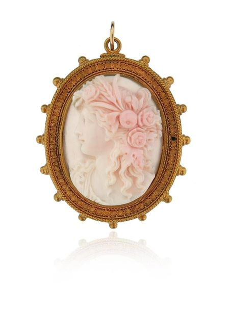 A 19th century shell cameo brooch pendant, depicting Flora in profile within gol…