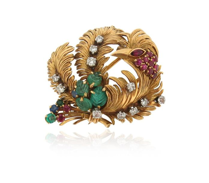 A French gem set phoenix brooch, set with carved emeralds, rubies a sapphire and…