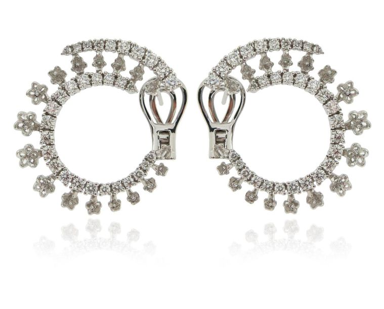 A pair of diamond hoop earrings, set with graduated round brilliant cut diamonds…