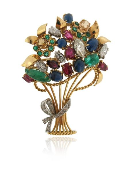A gem set giardinetto brooch, set with emeralds, rubies, sapphires and marquise …