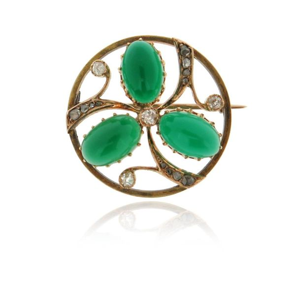 A chrysoprase and diamond circular brooch, set with cabochon chrysoprase in the …