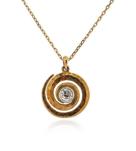 A diamond set gold pendant, the hammered gold swirl centred with an old circular…