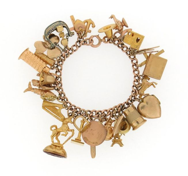 A gold charm bracelet, the gold curb link bracelet mounted with thirty two assor…
