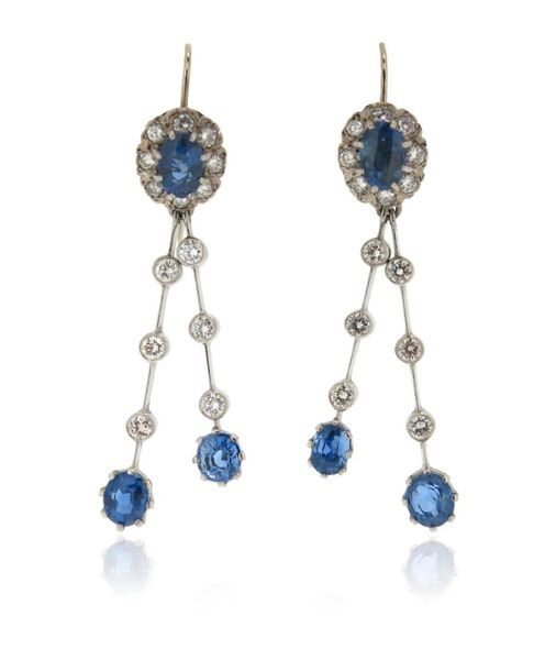 A pair of sapphire and diamond drop earrings, the sapphire and diamond cluster u…