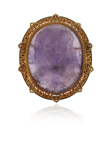 A 19th century carved amethyst cameo brooch, portraying the bust of a woman with…