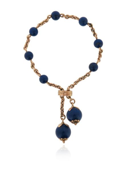 A Victorian lapis lazuli and gold bracelet, with sliding gold clasp and a larger…