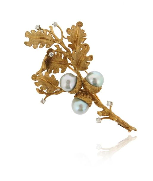 A stylised cultured pearl and diamond oak branch brooch, the textured yellow gol…