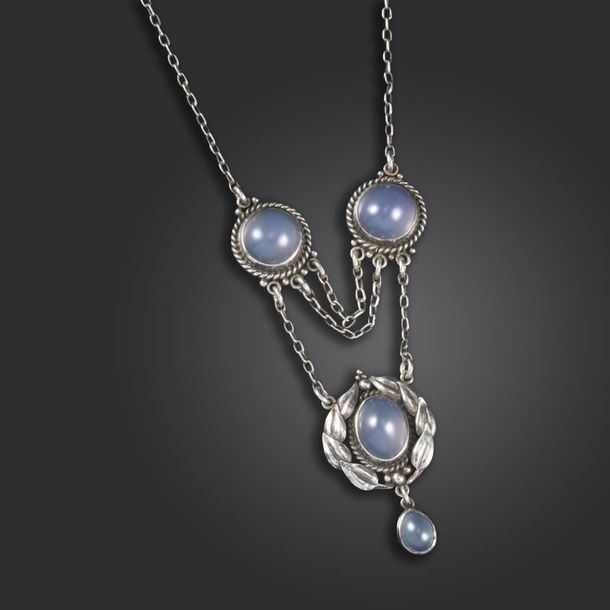 An Arts & Crafts silver and chalcedony pendant possibly by Edith Stewart, the fi…