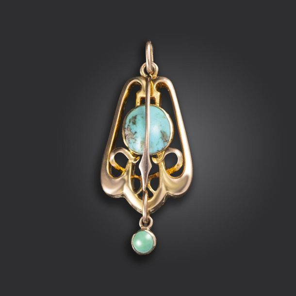 An Arts & Crafts turquoise and gold pendant, in the Liberty style, the turquoise…