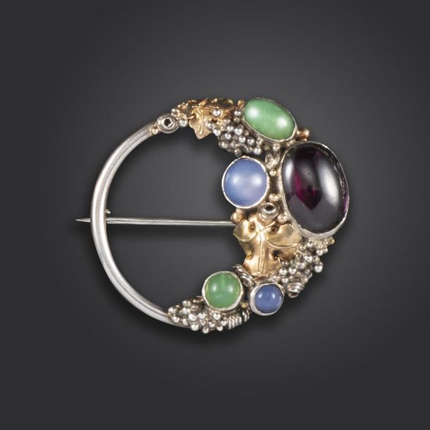 An Arts & Crafts gem set silver brooch attributed to Dorrie Nossiter, set with a…