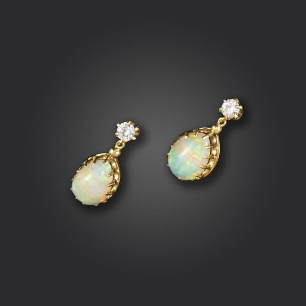 A pair of opal and diamond drop earrings, the round brilliant diamonds suspend p…