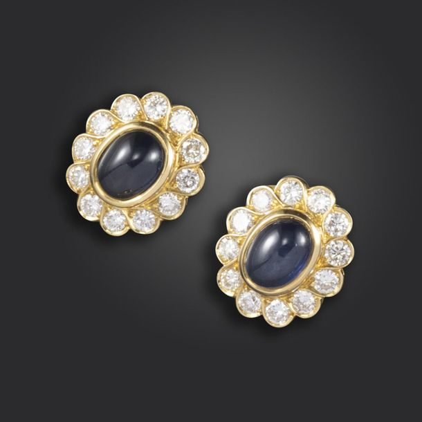 A pair of sapphire and diamond cluster earrings, set with cabochon sapphires wit…