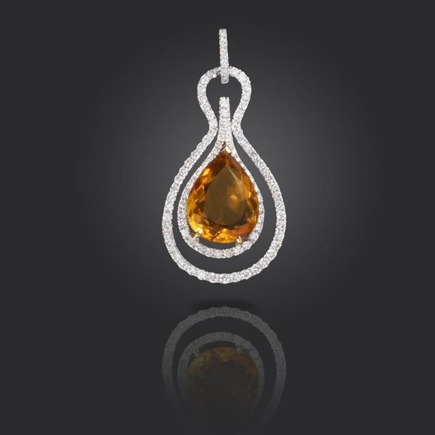 A citrine and diamond pendant, centred with a pear shaped citrine within a borde…