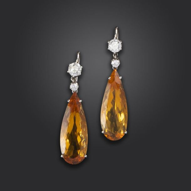 A pair of citrine and diamond drop earrings, each pear shaped citrine suspends f…
