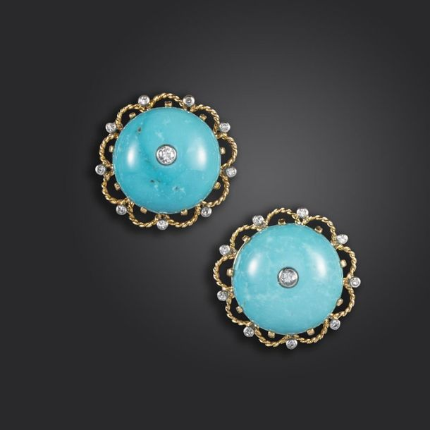A pair of turquoise and diamond earrings by Cartier, the circular turquoise cabo…