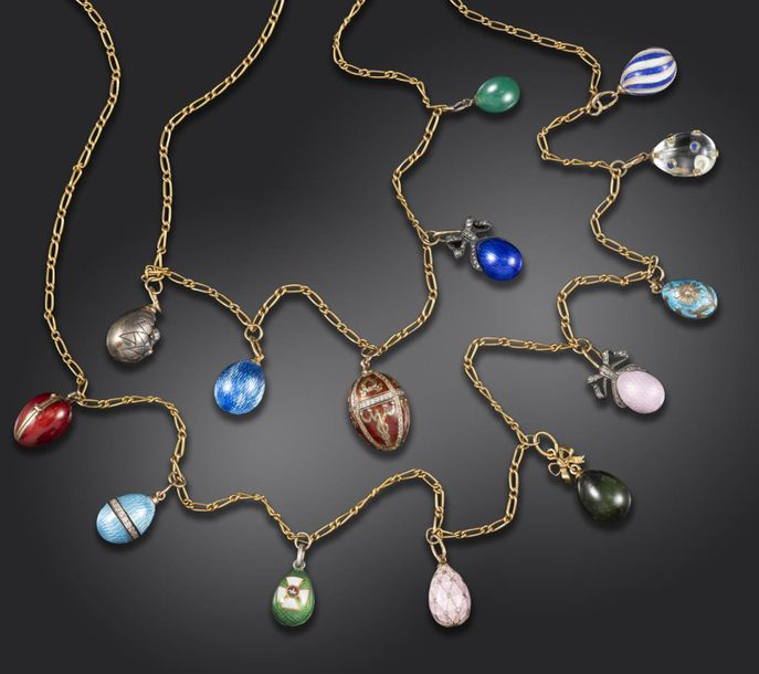 An early 20th century gold necklace suspending fourteen miniature egg pendants, …