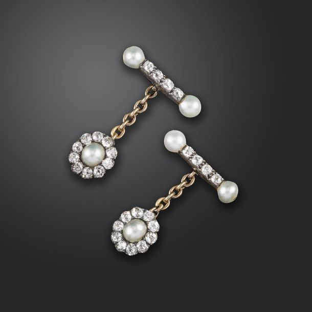 A pair of diamond and untested pearl cufflinks, formed with a pearl and old cush…