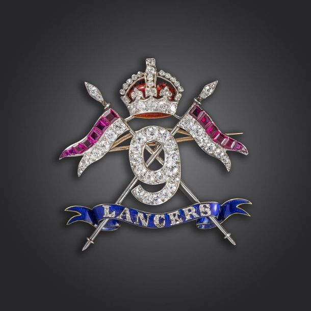 An impressive gem set Regimental brooch for the 9th Lancers, set overall with ci…