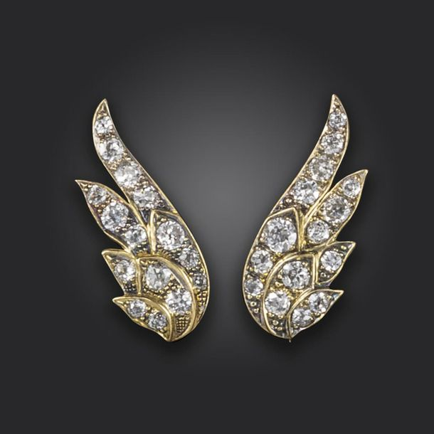 A pair of diamond set earrings, in the form of stylised wings, set with graduate…